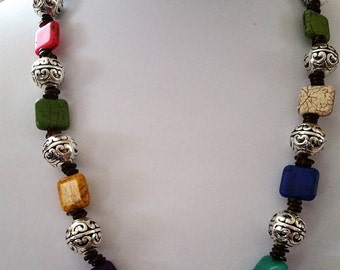 Fun necklace with silver beads and colorful square beads.