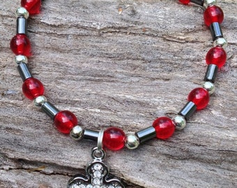 Red, silver, and hematite charm bracelet