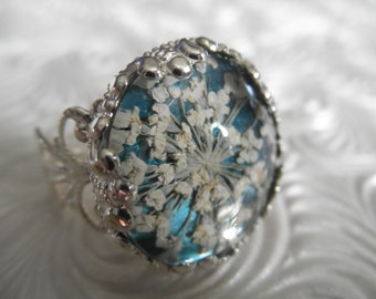 Queen Anne's Lace Victorian Filigree Pressed Flower Ring Atop Glowing Teal Background, Symbolizes Peace-Nature's Wearable Art-Gifts Under 20