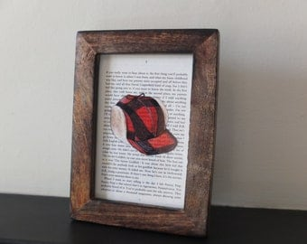 The Catcher in the Rye Art print Framed book page J D Salinger Holden Caulfield red hunting hat distressed dark wood frame