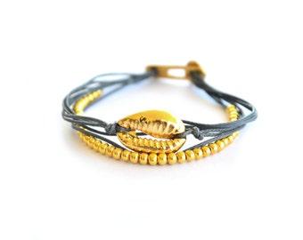Gold cowrie wrap bracelet