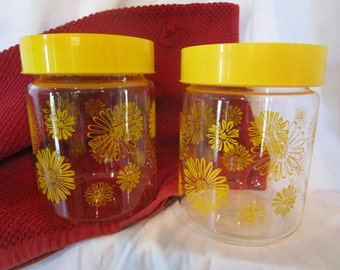 yellow daisy canisters, corning glass canisters, daisy storage jars, daisy kitchen decor, yellow daisies, glass jars, jars with lids, retro