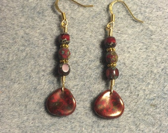 Red Picasso Czech glass rose petal dangle earrings adorned with red Picasso Czech glass beads.