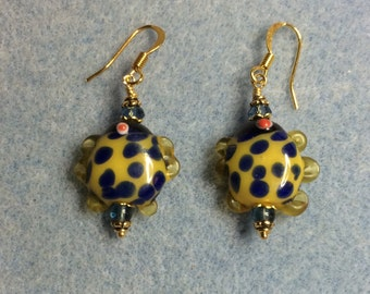 Blue and yellow polka dot lampwork fish bead earrings adorned with blue Czech glass beads.