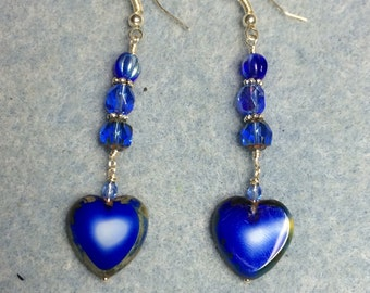 Blue opaque glass heart dangle earrings adorned with dark blue Czech glass beads.