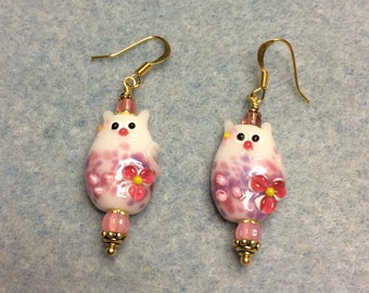 Pink lampwork cat bead earrings adorned with pink Czech glass beads.
