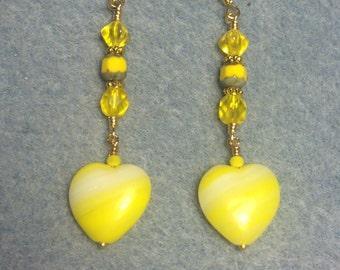 Bright yellow Czech glass heart bead dangle earrings adorned with yellow Czech glass beads.