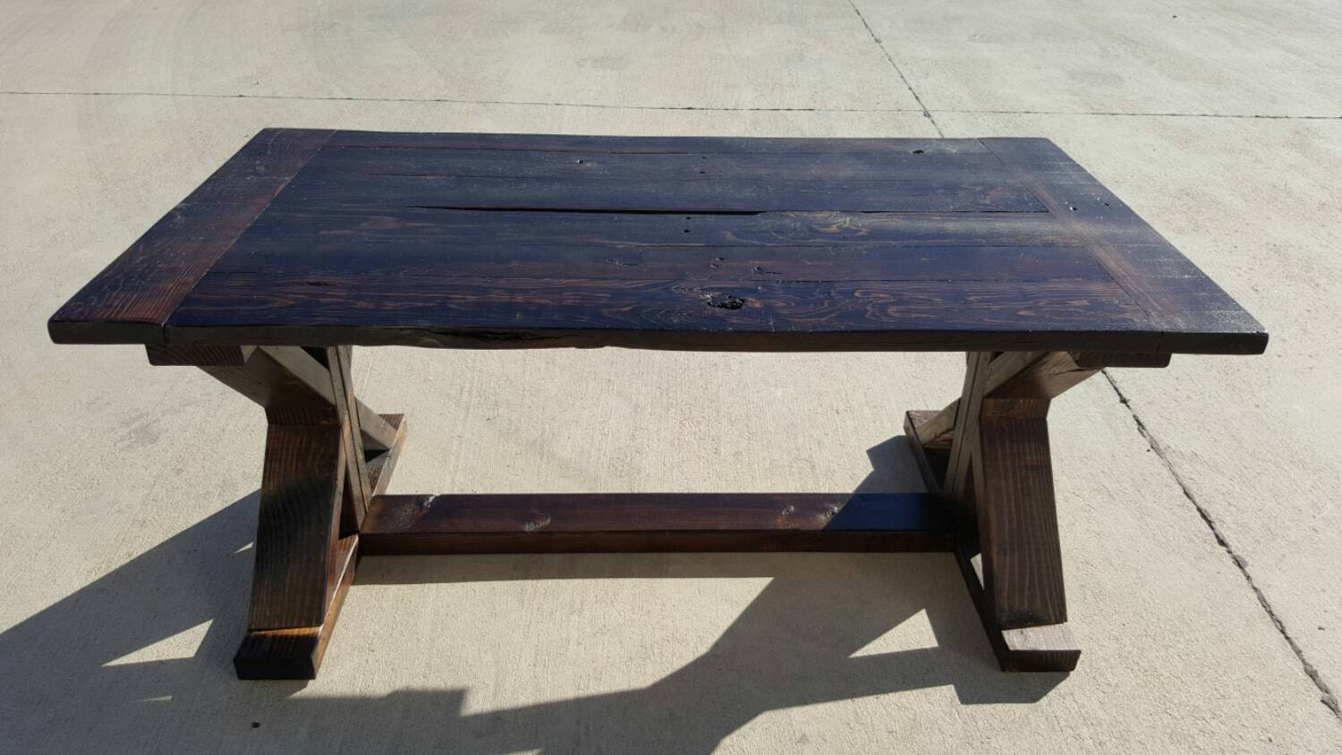 farmhouse style coffee table with distressed stained trestle. Black Bedroom Furniture Sets. Home Design Ideas
