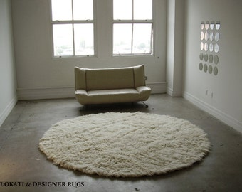 "Authentic 8' Round natural white flokati shag rug. 2.5"" low profile shag pile. Hand made. 100% wool - no synthetics."