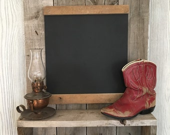 Rustic chalk board with shelf and square nails to hold your keys etc.