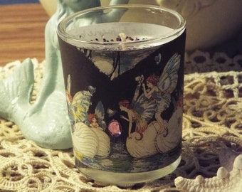Faeries riding on the water small candle