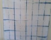 Shibori Wrap with square Shibori design hand-dyed in indigo.
