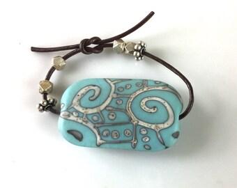 Turquoise lampwork glass bead