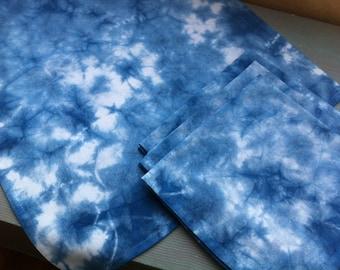 Set of four Shibori indigo dyed cotton dinner napkins scrunch dyed