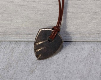 Hand Forged Guitar Pick Pendant - Gold Teeth