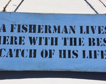 A Fisherman Lives Here With The Best Catch Of His Life wood sign.