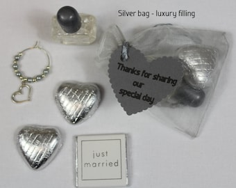 Silver wedding favour bags with a selection of fillings - heart, butterfly, flower or lovebird theme