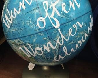 Wander Often, Wander Always globe
