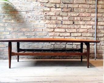 Surfboard Walnut Coffee Table by Bassett Furniture