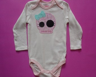 Body with skull with bow