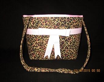 Cheetah print purse with a pink ribbon and bow