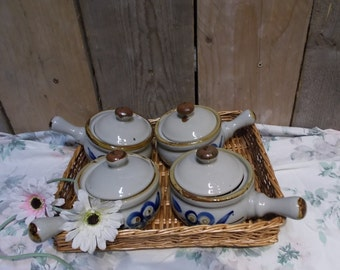 Set of four vintage soup bowls in basket