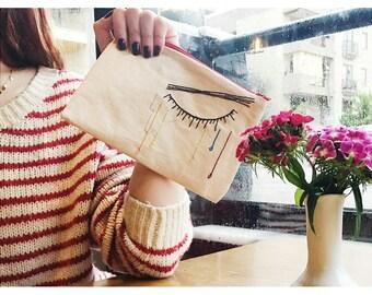 Makeup bag / Crying woman hand embroidery on linen