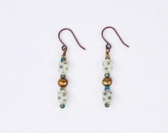 Gold pearl double dot earrings
