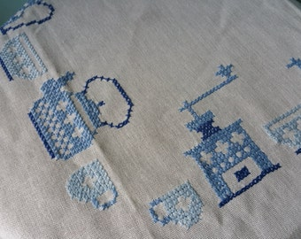 Lovely small tablecloth with embroidered coffeegrinders and coffeepots! Great for coffee table high tea etc.