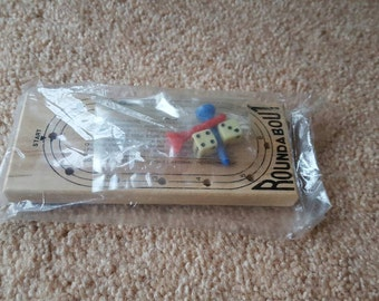 Roundabout peg and dice game, sealed