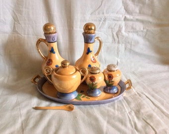Lustreware cruet set on tray with spoon