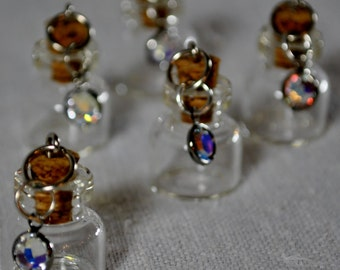 "1/2"" corked glass bottles with charm."