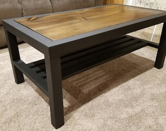 Metal and Wood Coffee Table with a bottom shelf.