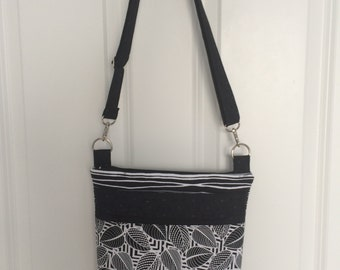 Handmade multipocketed fabric purse.