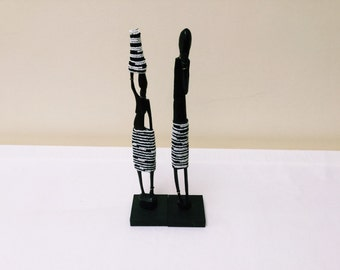 Black and white couple carving