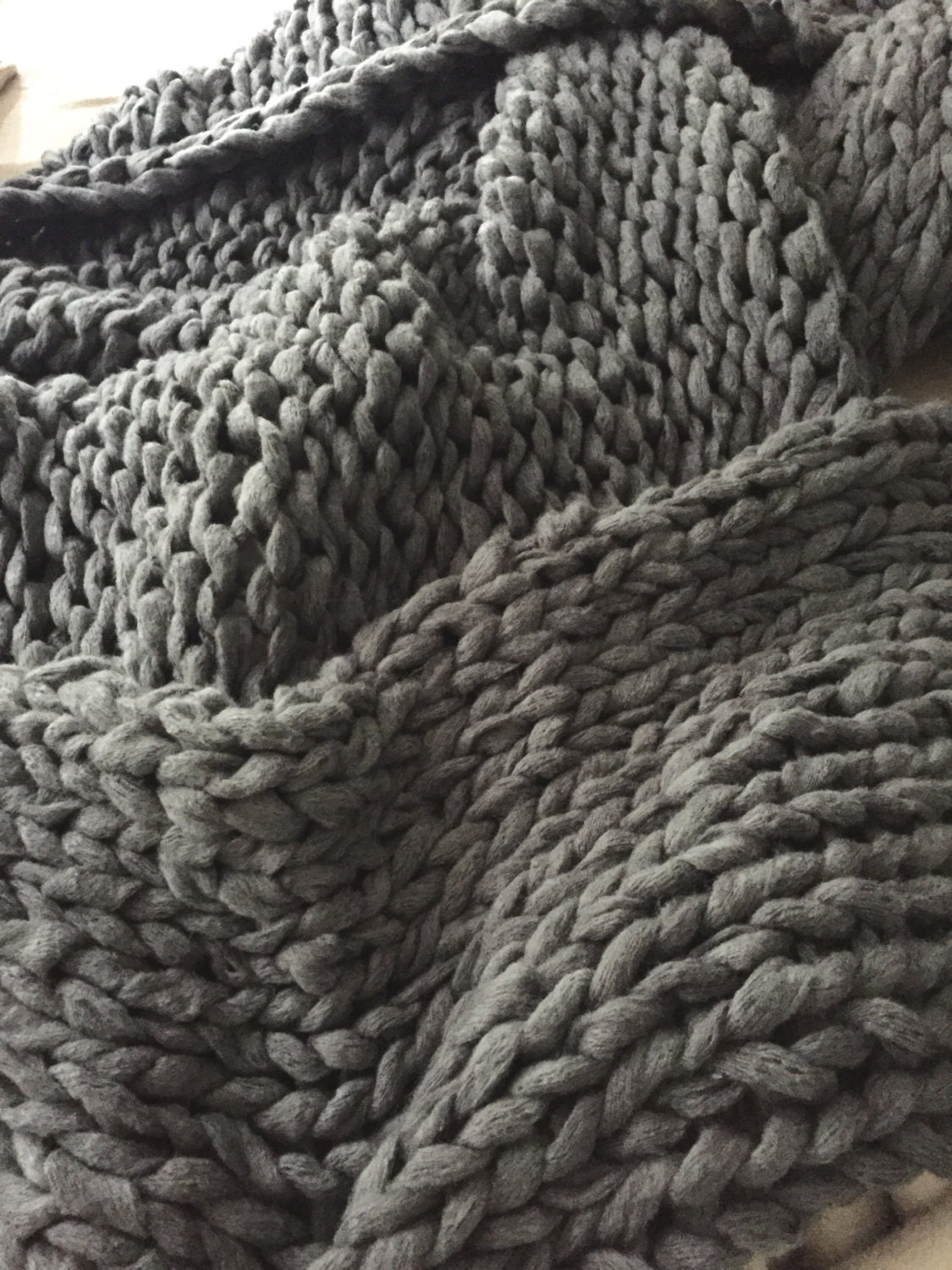 Make a chunky arm knit throw from 'Happy Happy Nester'. So these are incredible, but if you don't want to DIY this, but just have to have one (and it fits your budget) you can buy them! We found out fav online at ' Nickel N Co.'.