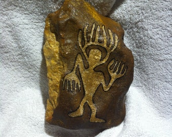 Shaman with a feather crown - rock petroglyph after a motive of the Hopi in Arizona datimng bach to around 600 BC