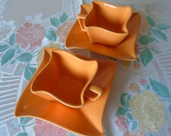 square curvy bright orange cups and saucers x 2