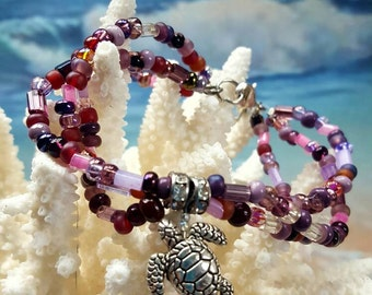 Sea turtle bracelet. Triple strand of purple glass beads