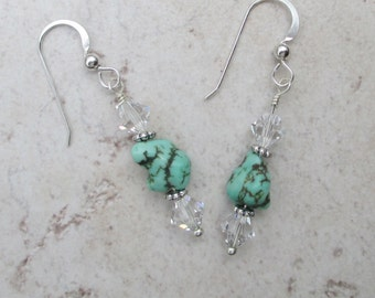 Turquoise earrings with clear Swarovski crystals on a sterling silver ear wire