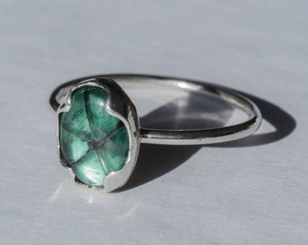 Adjustable silver and emerald ring