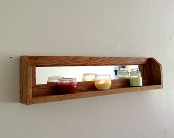 Wall shelf with a mirror