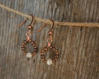 Delicate earrings in copper