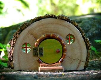 Rustic Wooden Hobbit house with Opening Green Door and Bark Roof