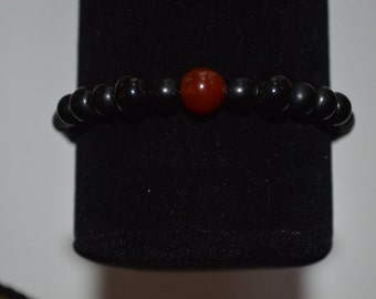 Black with garnet and silver accents stretch bracelet