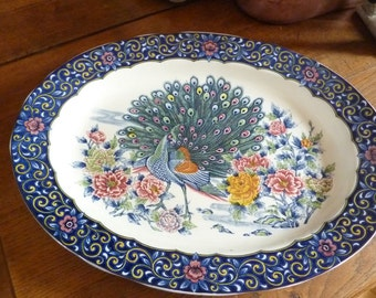 large dish in earthenware with signature CHINA former Peacock decor and flowers