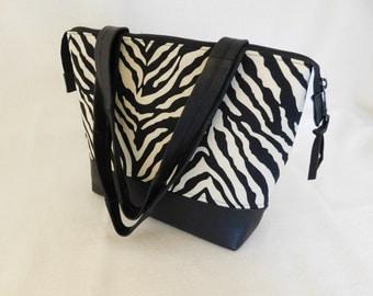 Handmade repurposed black leather and zebra print zip top bag