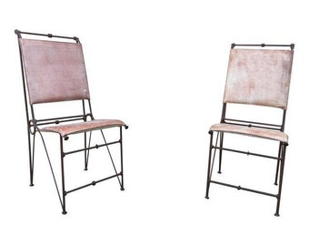 Two Iron Chairs With Saddle Leather.