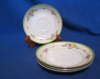 Four (4) hand-painted saucers manufactured in Japan
