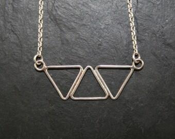 Necklace trapeze pendant